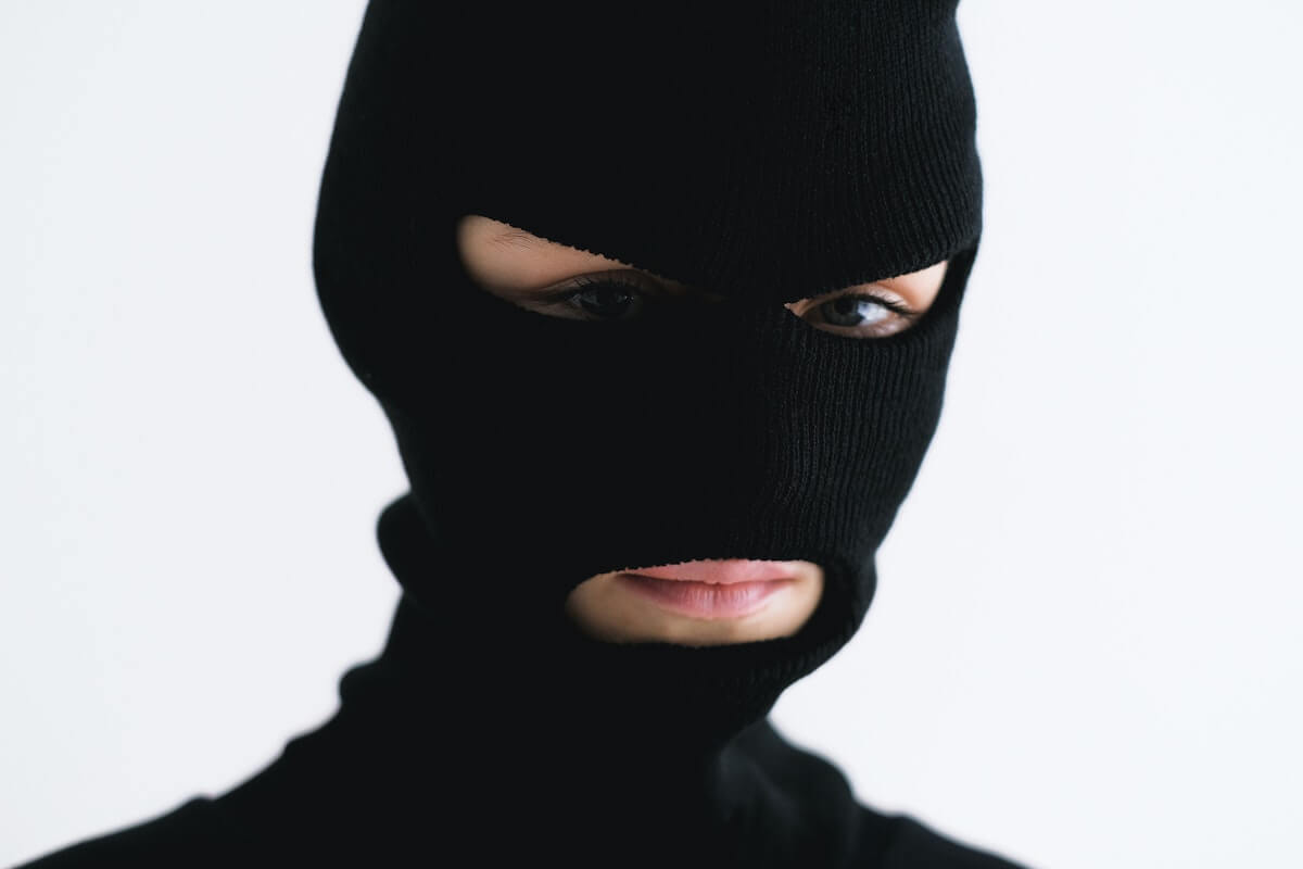 person wearing black face mask