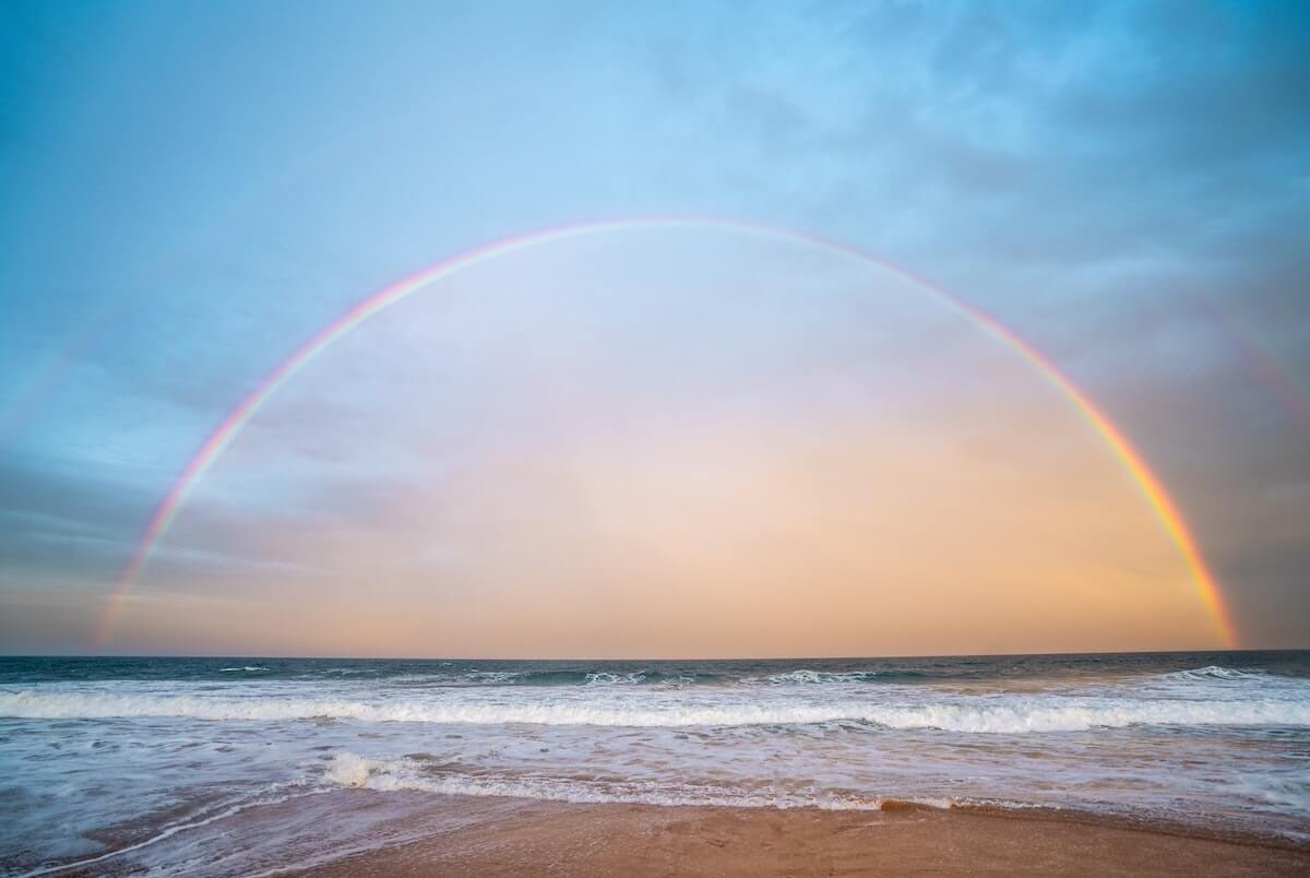 a rainbow visible from the coast